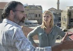 """""""Homeland"""": The first and second seasons, in one messy gulp! Twenty-four hours total. Why, I could be done in a ... day. """"Homeland"""" is perfect for the TV gluttons among us — a plot that spins quickly, so quickly that all it took was two seasons for Brody (Damian Lewis) to return home from Iraq a hero, to staging a terror plot ... to running for Congress (and winning) ... to having a messy, torrid affair with Carrie (Claire Danes) ... to making an escape to Canada. Burp."""