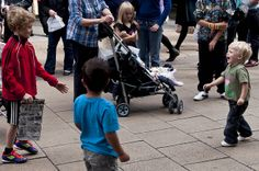 Are the subjects in a circle or is there a collection of golden triangles? Either way it works. The emotions are brilliant.  ~Brotherly Love/The Street Entertainer by Rob (M) Andrews, via Flickr