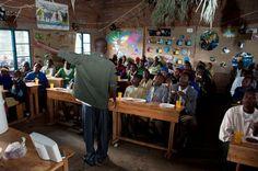 innocent-with-a-packed-classrrom-at-nyabitsinde-primary-school-northern-province-rwanda-aoc-2009.jpg