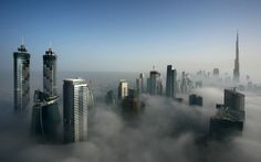 "The world's tallest building and Dubai's skyscrapers poke through thick fog.  Ian says: ""We get fog twice a year, in March and September, when the seasons change. The moisture in the morning cools and the fog start to appear. It reminds me of the cloud planet Coruscant with its Cloud City in Star Wars.""     Picture: Ian Powell / Barcroft Media"