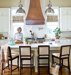 copper hood, range between windows, white kitchen