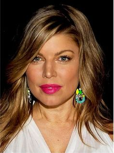 Fergie fab.  Loving her hair color..