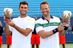 MASON, OH - AUGUST 19:  Horia Tecau of Romania and Robert Lindstedt of Sweden pose for photographers after defeating Mahesh Bhupathi and Rohan Bopanna of India during the final of the Western & Southern Open at the Lindner Family Tennis Center on August 19, 2012 in Mason, Ohio.  (Photo by Matthew Stockman/Getty Images)