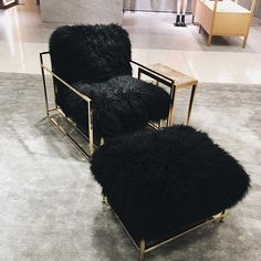 Fuzzy black chairs. @thecoveteur