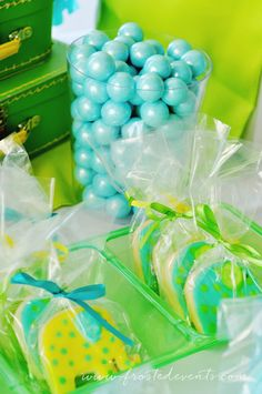 Cookies A Bright and Fun First Birthday!  Frosted Events--  The cutest little boy birthday party in aqua blue, yellow and green.  Chevron and dot patterns, a gorgeous dessert table, cute elephant party hat and party favors, elephant decorated cookies and cupcakes, a popcorn bar and lots more!   #firstbirthday #boysfirstbirthday #babyelephant #blueandgreen #blueandyellow #kidsparty #desserttable