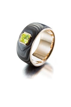 """One of the """"Goldsmith of the year competition entry ring. Black coated Damascus, greenish-yellow diamond and gold. Damascus Ring, Damascus Steel, Institute Of Design, Year 2016, Petra, Competition, Rings For Men, White Gold, Rose Gold"""