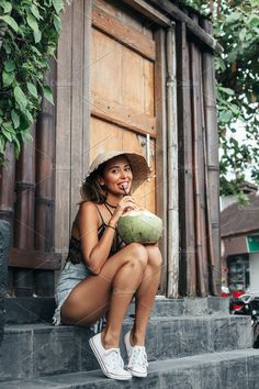 Young woman drinking coconut juice by JohanJK. Portrait of attractive young woman drinking coconut juice. Happy girl relaxing on summer vacation Water Photography, Lifestyle Photography, Photography Poses, Fashion Photography, Foto Casual, Beach Poses, Trendy Girl, Summer Pictures, Beach Pictures