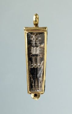 Pendant  Museum number: 1978,1002.117  'Memento mori' gold pendant in the form of a coffin enamelled in black and white with a hinged rock-crystal cover and a skeleton in high relief. The reverse and insides are enamelled with tongues of fire.  Date: 16thC  Source: British Museum