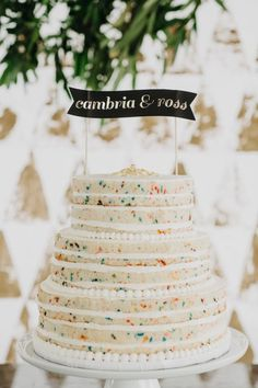 Modern funfetti wedding cake: http://www.stylemepretty.com/2016/04/08/a-navy-yard-wedding-with-boston-skyline-views/ | Photography: Dylan and Sara - http://dylandsara.com/: