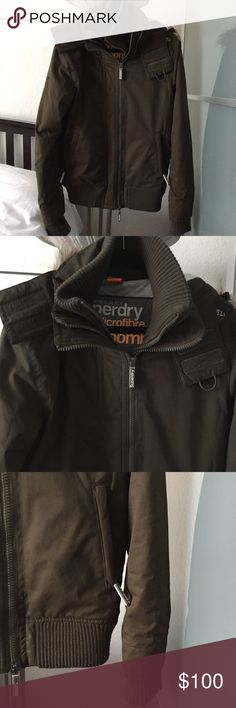 Superdry Microfibre Windbomber Jacket Superdry microfiber windbomber jacket with fur hood. Soft, quilted jersey lining, faux fur trimmed hood (removeable trim), double collar with inner ribbed layer, ribbed cuffs with thumb holes, two-way triple layer zipper fastening, outer pockets and ribbed, elasticated hem. Worn twice. Superdry Jackets & Coats