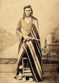 Defeated and temporarily deported from his native land, this undaunted and stern-visaged Nez Perce man poses in tribal costume and prominently holds a Colt Model 1860 Army, Richards-conversion revolver, in this circa 1880 carte de visite by H Beck of Winfield, Kansas.– Courtesy Dickinson Research Center, National Cowboy & Western Heritage Museum, 2004.015.3 –