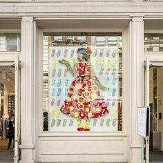 """""""Girl"""", made of rolled socks at SoHo New York, standing between the doors that… Installation Art, Soho, Doors, Sculpture, Frame, Instagram Posts, Red, Home Decor, Picture Frame"""