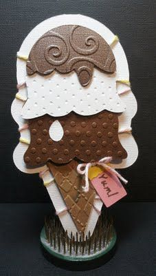 "RECIPE - Cricut Cuts Used: Ice Cream Cone from ""Sweet  Treats"" @ 5.12"" - Card Base was 2 cones welded together in Gypsy - Tag from ""Sweet Treats"" @ 1.24"" - My Pink Stamper:  ""Sweetest Cupcakes"" - Cuttlebug Folders used: ""Seeing Spots"", ""Swiss Dots"", ""Swirls"", & ""Argyle"" - Twine: My Mind's Eye"