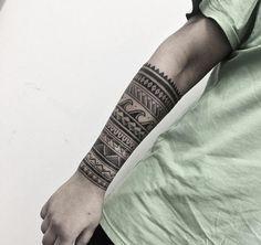 Banded tribal sleeve tattoo