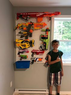 Kate's Kitchen: Nerf Wall The Effective Pictures We Offer You About Nerf Gun Storage led A quality p Cool Bedrooms For Boys, Awesome Bedrooms, Kids Bedroom, Nerf Gun Storage, Game Room Decor, Toy Rooms, Baby Boy Rooms, Playroom Organization, Video Game Rooms