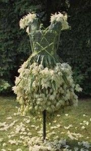 """Nicole Dextras as created this """"Weedrobe"""" which uses detritus flowers and weeds to create wearable artwork."""