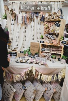 photo by Kate Stamas(Renegade Craft Fair) ... Block printed background fabric, good height + layers of products