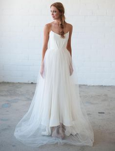Tara LaTour Fall 2016 white strapless scoop neckline and tulle overlay wedding dress | https://www.theknot.com/content/tara-latour-wedding-dresses-bridal-fashion-week-fall-2016
