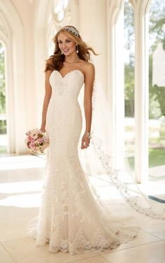 Fit-and-flare strapless wedding dress from Stella York, made from gorgeous lace over rich satin with hand-sewn Diamante embellishments throughout.