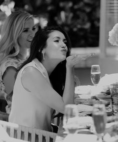 Once again, he loves kisses and loves to see her giving them, particularly to him. It seems like they're at a nice casual day party, and he would like to see her drinking, especially since it's so rare. She looks really pretty here, and he would love the artistic black and white filter. Also seems to be in the moment.