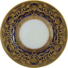(B & Co)  L. Bernardaud & Co. Limoges, France, White center with cobalt blue plateau and swirls and swirls of ornate raised gold design with baskets of fruits and flowers