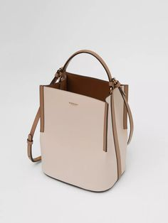 Burberry Handbags - An equestrian-inspired leather bucket bag framed with contrast-coloured edges featuring a - Calf Leather, Leather Shoulder Bag, Leather Bag, Shoulder Strap, Leather Luggage, Leather Boots, Burberry Handbags, Hobo Handbags, Burberry Bags