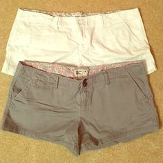 """2 American Eagle shorts  Stretch shorts. Both size 14. 98% cotton. 10"""" in length each. One pair white, the other a slate gray. American Eagle Outfitters Shorts"""