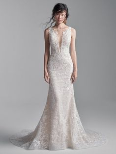 25542 - Edmund by Sottero & Midgley. The detail is stunning! Try this beauty on at Aurora Bridal in Melbourne, FL 321-254-3880