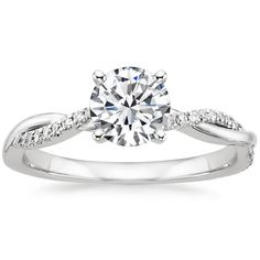 18K White Gold.... definitely one of my favorites! Engagement rings are so hard, how does a woman choose just one?! lol