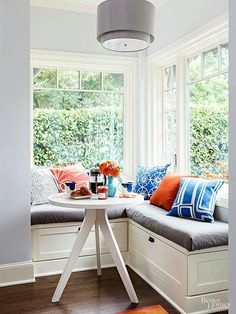 Skip the chairs and pair this clean-lined, colorful banquette with a simple three-legged table. The absence of excess furniture saves space in a tight kitchen and allows you to pull up extra seating when needed.