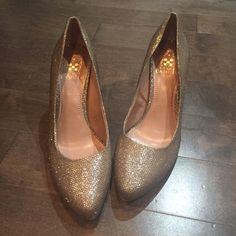 Gold and Silver Heels Gold and silver shimmery heels. They are Vince Camuto and are two inches. They have been worn once. Vince Camuto Shoes Heels