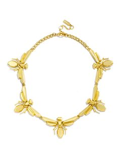 Olivia Palermo Guest Bartender Collection. A sophisticated gold bug motif is at once whimsical and architectural.