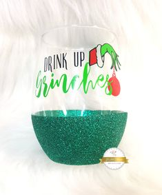 "This listing is for a set of (4)wine glasses with the phrase ""DRINK UP GRINCHES. Perfect for the holidays or that one person you know that's always a grinch around christmas, but you know loves to drink ;) These beautiful wine glasses will have everyone talking! Comes in the colors pictured, no customization can be done on these."