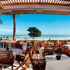Having sundowners at a Camps Bay restaurant...a staple for summer living