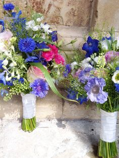 The bridesmaids handties of scabious, delphiniums, cornflowers lissianthas and hot pink spray roses x