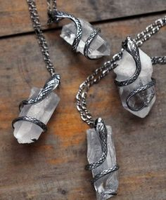 silver snakes and quartz necklace. These are so cool!