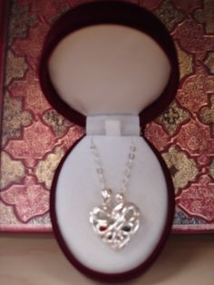Loving Family heart locket..a crystal to represent each family member inside...