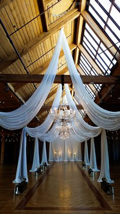 An absolutely stunning ceiling drape design with hanging crystal chandeliers at Bridgeport Art Center Wedding Reception Decorations, Wedding Venues, Wedding Ceiling, Decoration Evenementielle, Event Lighting, Ceiling Decor, Event Decor, Wedding Designs, Wedding Ideas