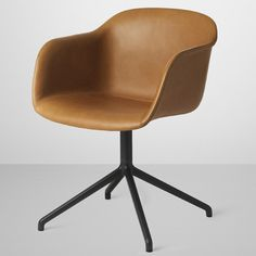 Fiber chair by Iskos-Berlin for Muuto - This chair was originally made in fibre-glass but later changed to polypropylene – creating a sustainable alternative. Love the smooth leather look of this chair.