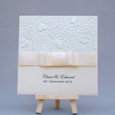 Folded card with embossed paper and ribbon double bow from www.happyeverafter.ie