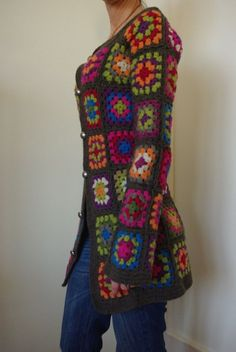 love love love love love. and i've gone on the record mocking granny square sweaters. this one is gorgeous. could risk being too bulky but she made it well.
