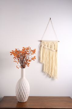 """Off white / Cream Vintage Modern - Fiber Art Macrame Wall Hanging Tapestry on Wood Bar with Brass Accents.  The """"Vintage Modern"""" Collection is inspired by my love for mid century modern and contemporary design. There is nothing wrong with mixing the old with the new! The pieces in this collection would be a great accent to a mid century space, but are so versatile that they can be used anywhere and in any decor style.  Size: Medium Materials: 100% wool"""