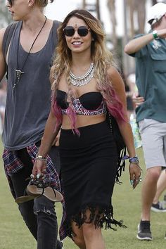 Vanessa Hudgens tackled two big festival trends: pink-tipped locks and face gems at Coachella.