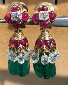 A pair of Mughal inspired European earrings, circa 1960. Old carved emerald beads, Burma rubies and 10ct plus of old briolettes.
