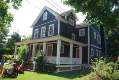 Wrap around porch..prussian blue exterior..Nantucket Red doors. - traditional - porch - new york