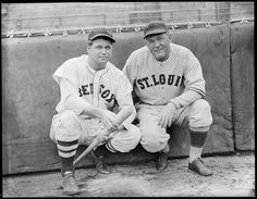 1936 - Boston Red Sox Jimmie Foxx and St. Louis Browns manager Rogers Hornsby crouching at Fenway Park.