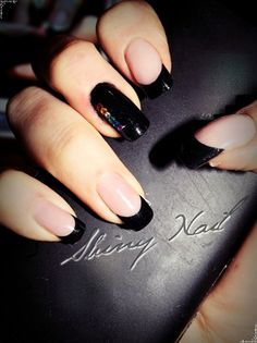 Black nails and rainbow rhinestones