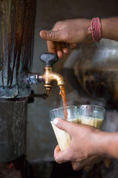 India Travel Inspiration - A chai wallah, tea seller, pours hot chai, a fragrantly spiced black tea with milk. Scenes from India: North | SAVEUR