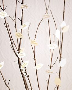 In lieu of an escort table, tuck leaves into slits in branches—guests will see the arrangement as a piece of modern art. It makes an understated impression but can be tailored to fit a more formal affair. Some ideas: Uplight the branches in a dramatic hue, or paint them white. The Details: Punch used: No. 12. Punches by Martha Stewart Crafts.