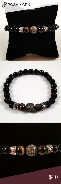 Men onyx/tiger eye, black rodhium , cz bracelet Men beaded bracelet. Fits most , 7.5 to 8.5 inch wrist . Handmade by me , never worn by anyone. Made with onyx beads, Tiger eye beads. Black rodhium plated cubic zirconia ball charm. Tibetan silver deco charms. I ship fast !!✈️ Free gift with every purchase!! Accessories Jewelry